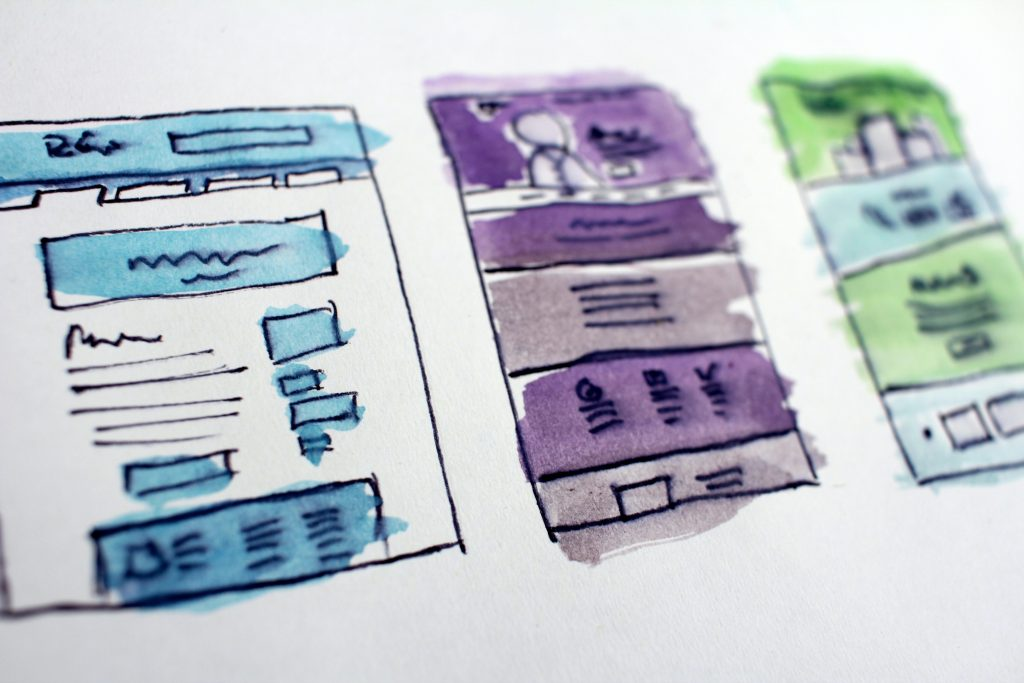 three drawings of a website design layout plan in blue, purple and green watercolour