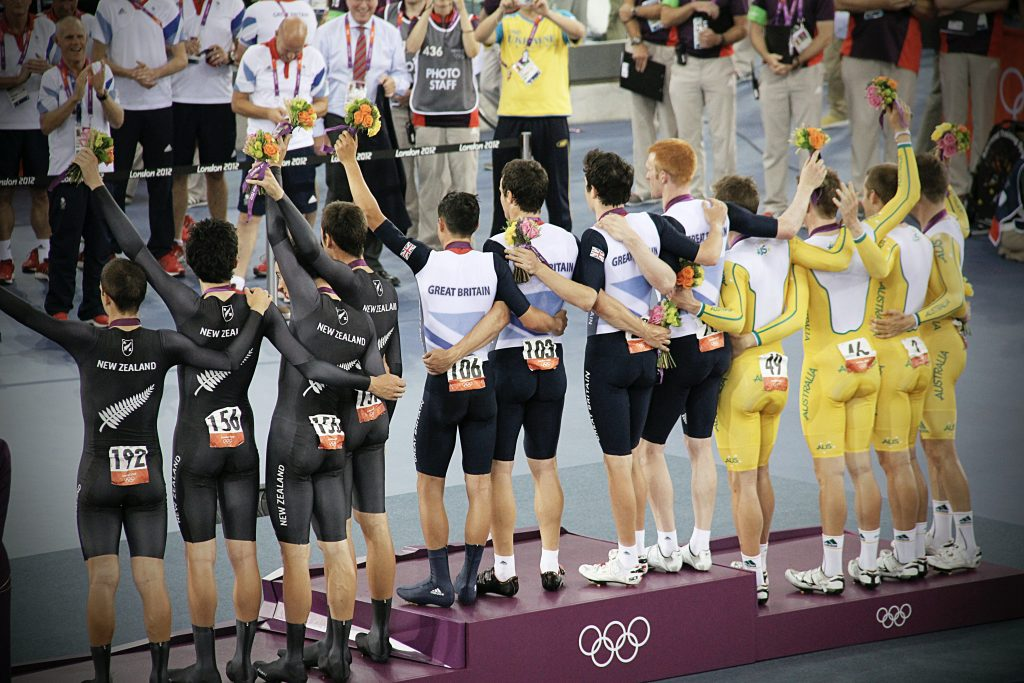 olympic winners showing off their medal