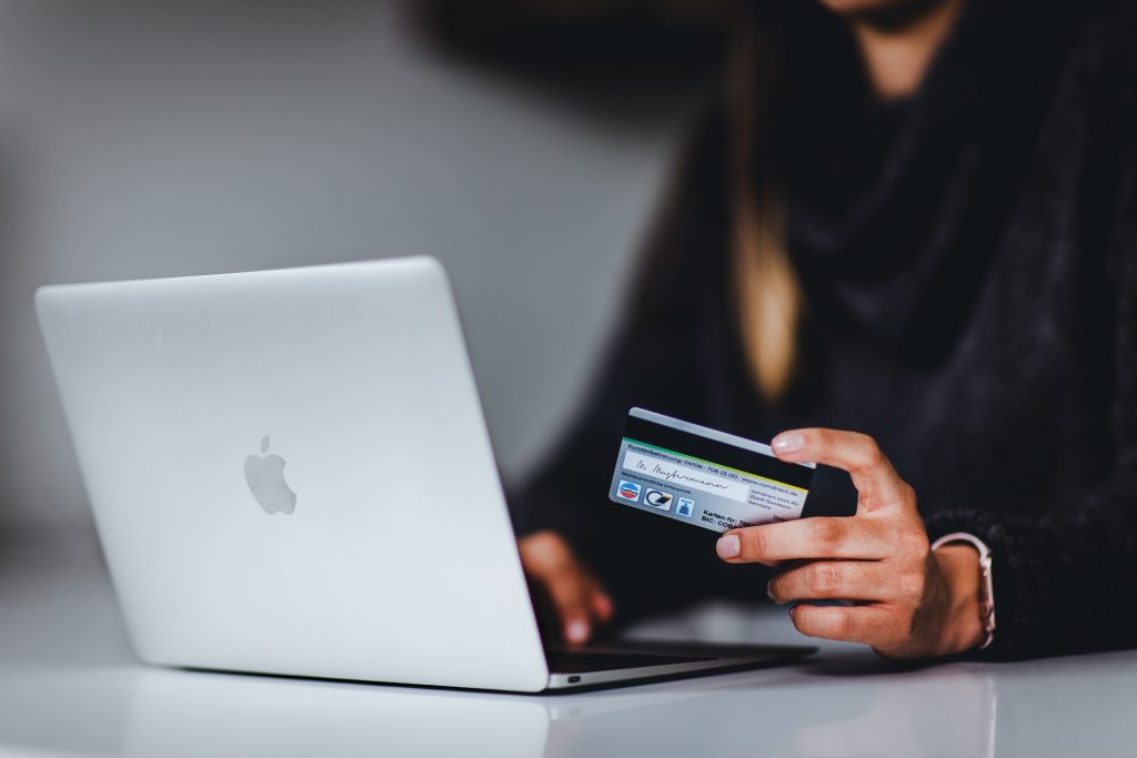 person at a laptop about to fill in their credit card details online.